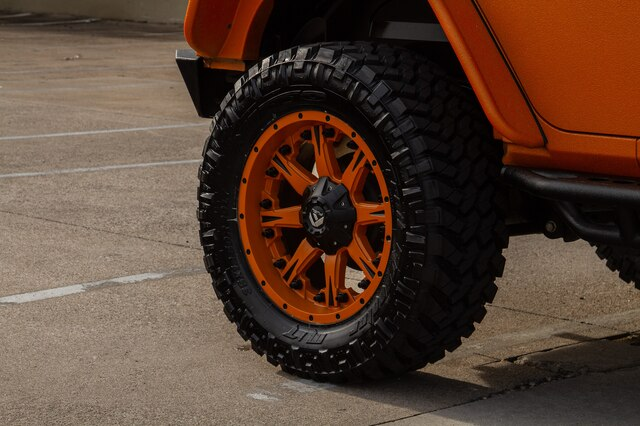Pre-Owned 2013 Jeep Wrangler Unlimited ORANGE CRUSH JK ProComp Lift Fuel Wheels